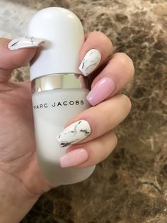 Pink with white marble nails