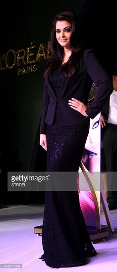 Indian Bollywood actress Aishwarya Rai Bachchan poses at the launch of a cosmetic brand in Mumbai late December 19, 2013.