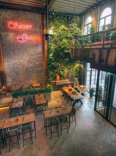 A secret garden with our beautiful vertical garden in the cozy restaurant De Vooruitgang in Eindhoven. Are you also looking for a secret garden for your place? Check our website for the possibilities: www. Deco Pizzeria, Deco Restaurant, Restaurant Concept, Bistro Design, Coffee Shop Design, Industrial Coffee Shop, Industrial Cafe, Rustic Coffee Shop, Cute Coffee Shop