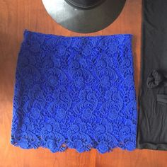Royal blue lace overlay skirt w/scalloped hem NWT Cute royal blue skirt with lace overlay. Side zip closure and elastic waistband. 100% cotton shell and 100% polyester lining. Say What Skirts Mini