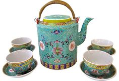"Chinese turquoise teapot with four cups and saucers. Dimensions: teapot, 6.5""H x 6.5""L x 5""W; cup, 3""H x 2.5""Dia; saucer, 1""H x 4""Dia."