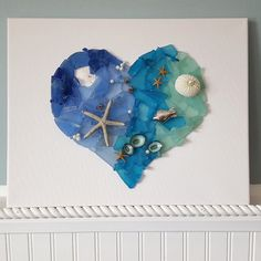 Artisan handmade watercolor sea glass art canvas. Beautiful heart shape with watercolor beach glass, beads, sea life and shells, this makes a beautifully thoughtful and unique beach gift! Sea Glass Decor, Sea Glass Art, Glass Wall Art, Nautical Wall Decor, Coastal Wall Art, Coastal Decor, Beach Watercolor, Beach House Decor, Pebble Art