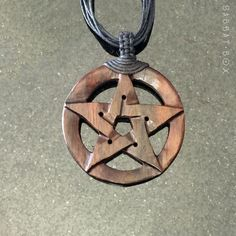 This Pentacle necklace has been beautifully carved from wood and comes with a multi-strand cord. It has been stained in a dark mahogany color, making this necklace unisex, for both men or women. One m