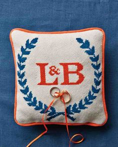 Lydia spent a month making the needlepoint ring pillow.