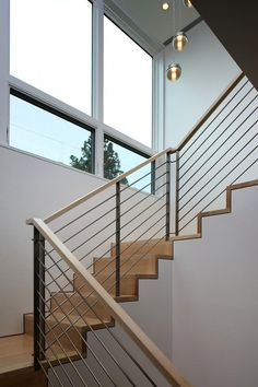 The minimally detailed stairs and railing combine wood and metal.