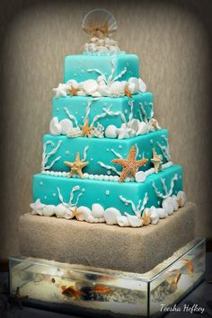 Beach Themed Wedding Cake on top of custom made fish tank base (with real fish! Lights are integrated in the cake and operated by remote-less switch. Uploaded by Teesha on Thursday Jan 24 2013 Submitted into the February, 2013 Inkedibles Contest Pretty Cakes, Beautiful Cakes, Amazing Cakes, Beach Wedding Reception, Beach Wedding Favors, Beach Weddings, Wedding Ideas, Cupcakes, Cupcake Cakes