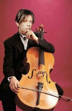 Although his character in the hunger played the cello, I would not be surprised if he himself learned to play...