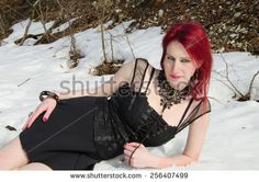 Portrait of sensual gothic woman lying in the snow. #Portrait #Snow #Winter #Gothic #Dark #Female #Lady #Tourism #Fashion #Model #Relax #Posing #Landscape #Nature #Mountain #Girl #Beauty