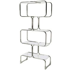 #bookshelf #shelf | Chromed Steel and Glass Four-Shelf #Etagere by Tricom, Italia | From a unique collection of antique and modern shelves at https://www.1stdibs.com/furniture/storage-case-pieces/shelves/