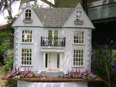 Newly finished wooden one inch to the foot scale Van Buren doll house. The house is not wired. The house is 29 inches high, 30 inches wide,...
