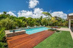 The grounds are a paradise, with a lap pool and spa, lush landscaping and multiple areas for lounging.