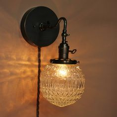 Reading Light - Wall Sconce - Custom Built with Clear Textured 6 inch Glass Globe and Oil Rubbed Bronze Finish. $179.00, via Etsy.