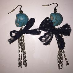 Handmade skull earrings These earrings are so cute and super special since they were hand made. I think the turquoise skull is the perfect touch, and goes perfectly with the black lace and chain :) Jewelry Earrings