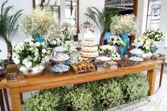 A wedding table with cupcakes and petite sweets.