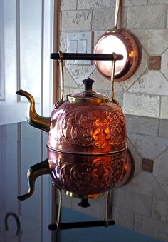 Antique English chased copper tea kettle