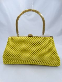 Just in! Vintage Whiting & David Yellow Metal Mesh Purse. Save up to 70% off retail at www.ShopKarma.com. High end pre owned designer bags, clothing, shoes and accessories. #karmacouture #shopkarma #upscaleresale #shopresale #consignment #designer #fashion #style #vintage #whitingdavis