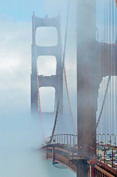 Golden Gate through the mist in San Francisco, California