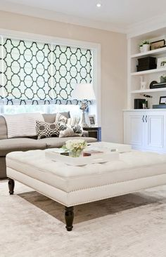 Lux Decor: Chic family room with light tan wall color and gray colored area rug. A contemporary ...
