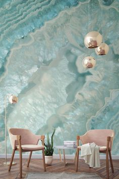"Want to know what a ""girl cave"" looks like? This crystal wallpaper and those blush pink armchairs are a match made in heaven! Stunning tones and a myriad of layers in this wall mural have an almost hypnotic effect. Perfect for modern living room spaces looking for a girly touch."