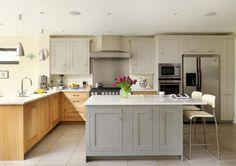 photo of bespoke calm open plan simple egg shell grey off white oak harvey jones kitchen with island kitchen island and american fridge