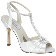 Izzie~Touch Ups by Benjamin Walk. Encompasses modern & contemporary styling to accommodate all wedding budgets. Perfectly created, comfortable & totally glamorous. A classic slimline high heel featuring a supportive ankle strap & diamonte side buckle, complimented with a Vintage T-bar design. A rounded peep toe & pleated satin vamp, finished with faux rhinestones on the T-bar to complete the look. They feature comfortable padding on the ball of the foot for comfort.  RRP £72.95 Our Price…