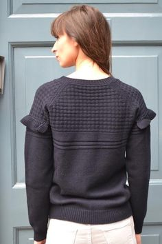 Beautifully detailed fine merino woollen knit sweater with variegated stitch patterning, contrast upper and light pleated knit trim over the upper sleeves and front.  100% Fine Merino wool.Hand wash.