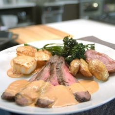 "Chef Paul Sturkey describes this Surf and Turf for Two as ""Great simple ingredients that cook fast."" He's talking jumbo sea scallops and flank steak. He's talking fingerling potatoes and caramelized broccolini. He's talking Arrabiatta sauce made with heavy cream and wait for it — a jar of Arrabiatta sauce. He's talking my language! Try this delicious 6 ingredient meal tonight. Surf And Turf, Seafood Recipes, Cooking Recipes, What's Cooking, Easy Diner, Chef Paul, Sustainable Seafood, Fingerling Potatoes, Tasty"