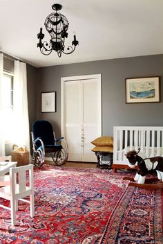 grey accent wall & red Persian rug (living room)