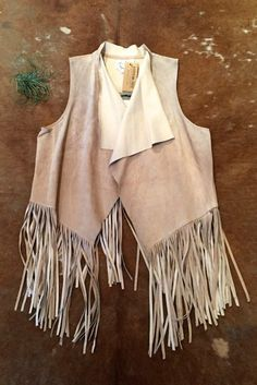 Pure bohemian mood with a slight nod to the modern day cowgirl. boho style, bohemian style, fringe, fringed vest, festival style,  Suede fringe vest in a beautiful nude tan color. Festivals or daily cruising around town...this