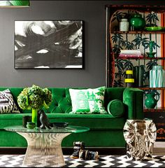 Emerald sofa, Platner table, black and white chevron rug, metallic elephant for whimsy.