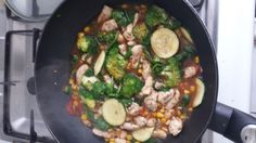 Chicken with super foods. Brocolli, courgette, tomato, spinach, corn in the wok with coconut cream. Added some gingerroot , sweet marinade and chiasseds