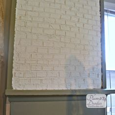 Easy faux bricks using drywall mud and a level. DIY brick wall treatment- messy but easy to do!