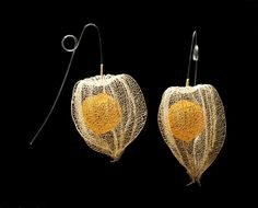 Fok, Nora, born 1952 (designer and maker)    Materials and Techniques:  Dyed and knitted nylon monofilament and skeletonised physalis (Cape gooseberry) shells