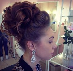 Volume, high bun, soft curls, quiff