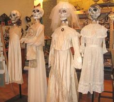 Skeleton Heads perched on dress forms make a Day of the Dead display for Halloween   Curious Sofa Diaries: Halloween Pics