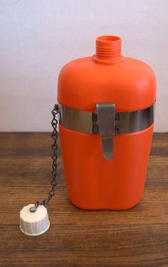 Unique retro Poloron orange flask with belt clip by AtomicMagpie