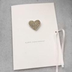 Konfirmasjonskort med håndlaget hjerte i sølv.