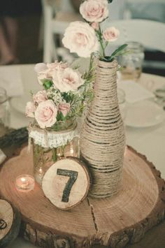 Love the lace with the twice on the mason jar--seems easy to make and pretty. Could fill with sand and candles, or flowers, or...? Rustic Style Wedding Centerpiece