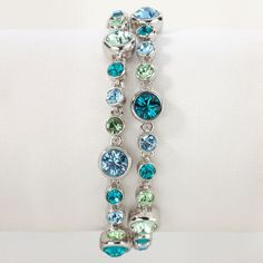 The Blue Sky Bracelet features TWO STRANDS of Swarovski crytals in various shades of blue. This showcase piece is absolutely stunning with denim, but is easily added to more formal attire. Shop now: https://www.mytouchstonecrystal.com/pws/finecrystaljewelry/tabs/shop-jewelry.aspx