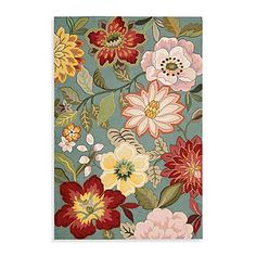 This beautiful, bold handcrafted rug by Nourison features a bright and colorful floral motif with shades of orange, red, yellow and green that pop off a blue background. Creates a magical ambience in every home-from transitional to traditional.