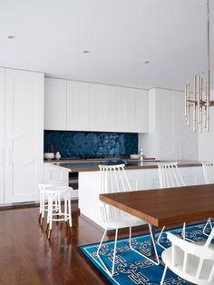 White kitchen with rich navy indigo blue tile backsplash in glossy finish