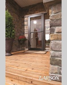 This Brown LARSON ScreenAway Storm Door Lets In Sunshine And A Spring