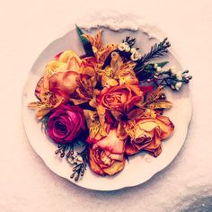 Made by Me using old flower bouquet - while preparing dinner - I took 1 of our plates and put ready composition on the snow on our balcony.