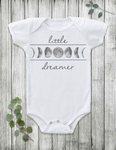 This bohemian moon phase Little Dreamer baby Onesie® bodysuit is the ideal, throw-on-and-go boho baby outfit for your baby boy or baby girl. Shop the onesie here: https://www.etsy.com/listing/273241486/boho-baby-clothes-baby-boy-clothes-baby?ref=listing-shop-header-1