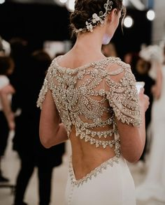 This back is AMAZING. All of that detail.  #bridal#lowbackweddingdress#lowback#wedding#bridalgown#weddinggown#weddingdress#dress#bridaldress#beading#buttons#bride#bridetobe http://gelinshop.com/ipost/1516250649736735160/?code=BUKze64A2m4