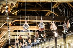 Ganda ham legs hanging from the roof! - Great Butcher's Hall Restaurant, Ghent, Belgium - www.finetraveling.com