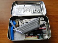 Survival Kit...Altoids tin...Fishing hook, needle, napkin, 2 fire strikers, 6 straw fire starters, tinfoil, 2 bandages, mini multi tool, 5 matches, 2 safety pins, 2 birthday candles, salt, 3 feet duct tape, fishing line, sewing thread, razor blade, 2 Advil and other pills you might need, Optional..Gum