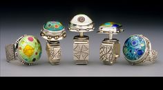 Cloisonne Enamel Desert Rings. Hand Made by Bailey's Jewelry. I own a ring very similar to the 2nd from the left in this photo. These folks are amazing artists!