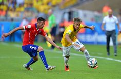 Neymar Photos Photos - Neymar of Brazil controls the ball against Mauricio Isla of Chile during the 2014 FIFA World Cup Brazil round of 16 match between Brazil and Chile at Estadio Mineirao on June 28, 2014 in Belo Horizonte, Brazil. - Brazil v Chile: Round of 16 - 2014 FIFA World Cup Brazil