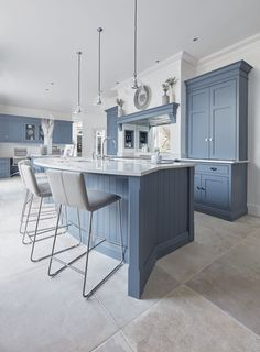 Prepare to spend quality time in this beautiful, welcoming kitchen. Its entire demeanour is one of quiet function, designed for effortless prepping and cooking and with space to socialise with friends and family. The unusual curved island in dusted oak veneer and finished in our unique paint colour, Periwinkle offers seating for eating and chatting.